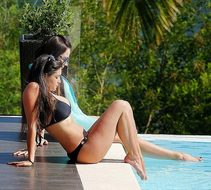 The 29-year-old, Casey Batchelor's certainly didn't one to shy away from displaying her incredible figure both on and off at the hotel poolside in Portugal on Saturday, May 10, 2014.
