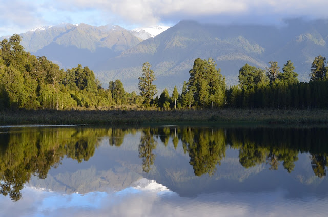 Lake Matheson showing reflections of Mount Tasman and Mount Cook in the distance