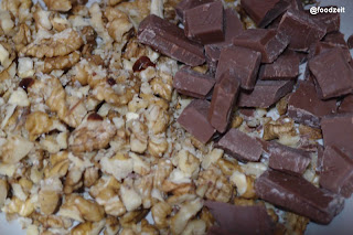 Chocolate pieces and crashed walnuts