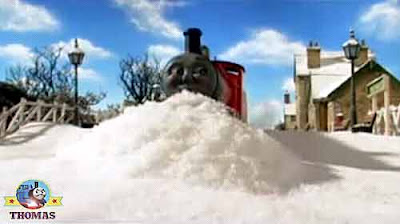 Red splendid James the train engine sliding in the Christmas snow Island of Sodor Marthwait station