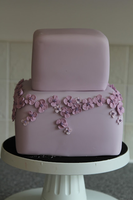 Two tier purple blossom cake