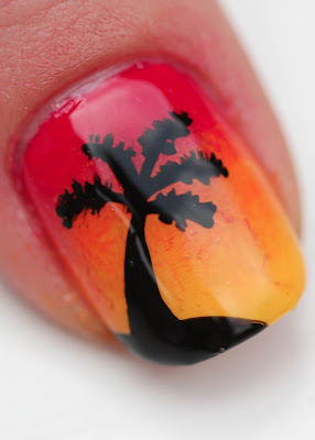 Sunset nail art with palm tree