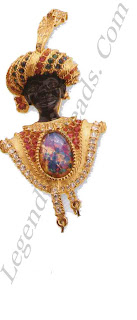 Inspired by Italian Renaissance and later neo-Renaissance Austro-Hungarian jewels, this characterful brooch signed B&W (Butler & Wilson) is an '8os classic. A Moorish prince, he is adorned with a jewelled turban (plus feather). His tunic is covered in faux rubies and is set in the centre with a faux fire opal. Two faux baroque drop pearls dangle at different heights from the bottom.