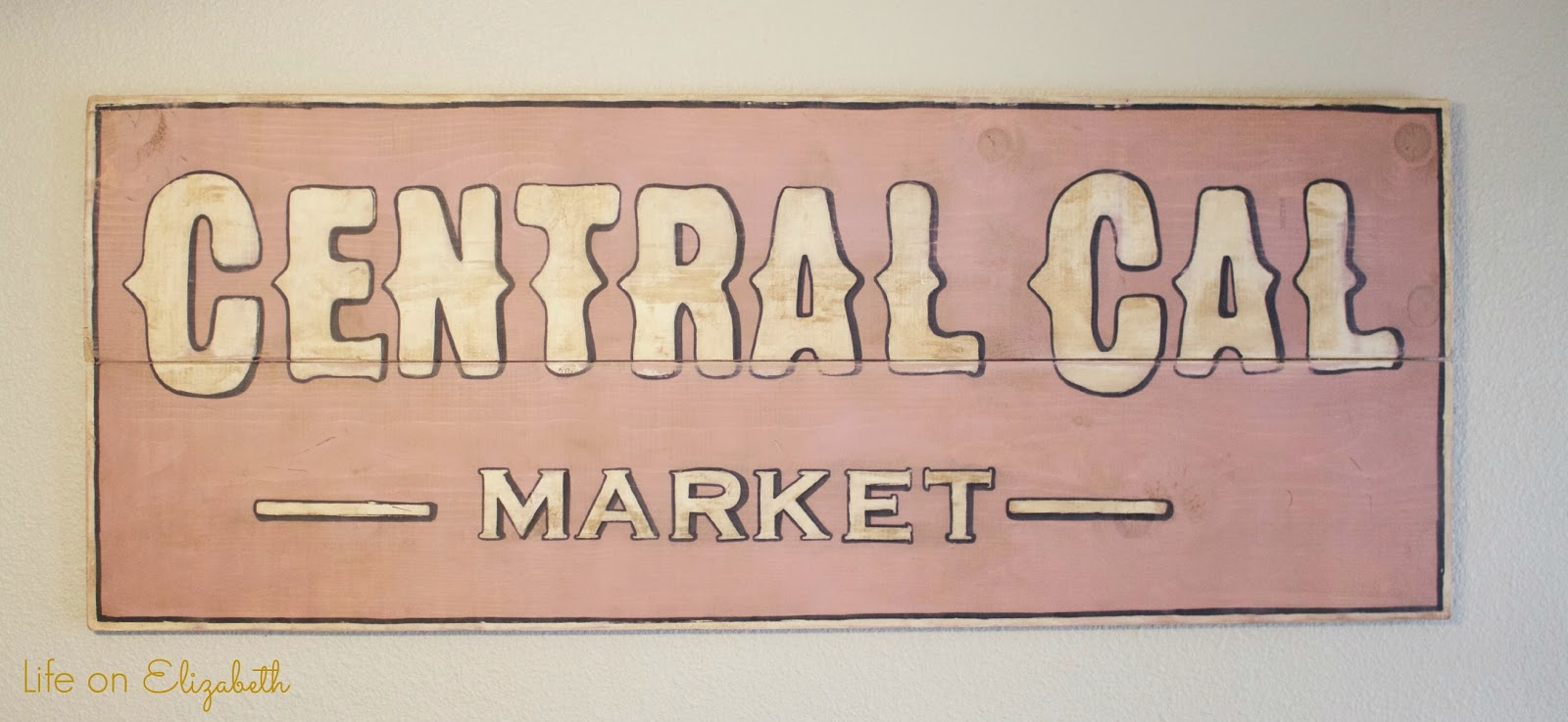 an antique sign i made using folkart home decor chalk paint
