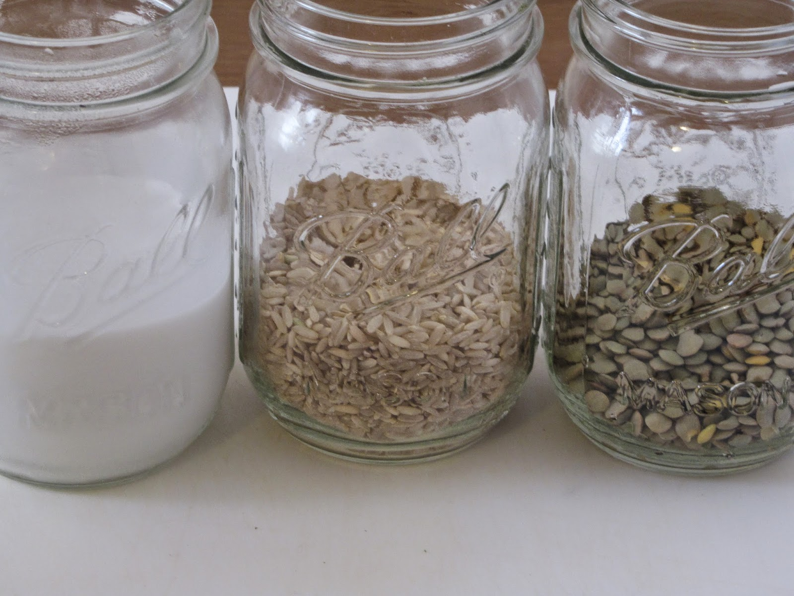 coconut milk, brown rice and lentils measured out into mason jars