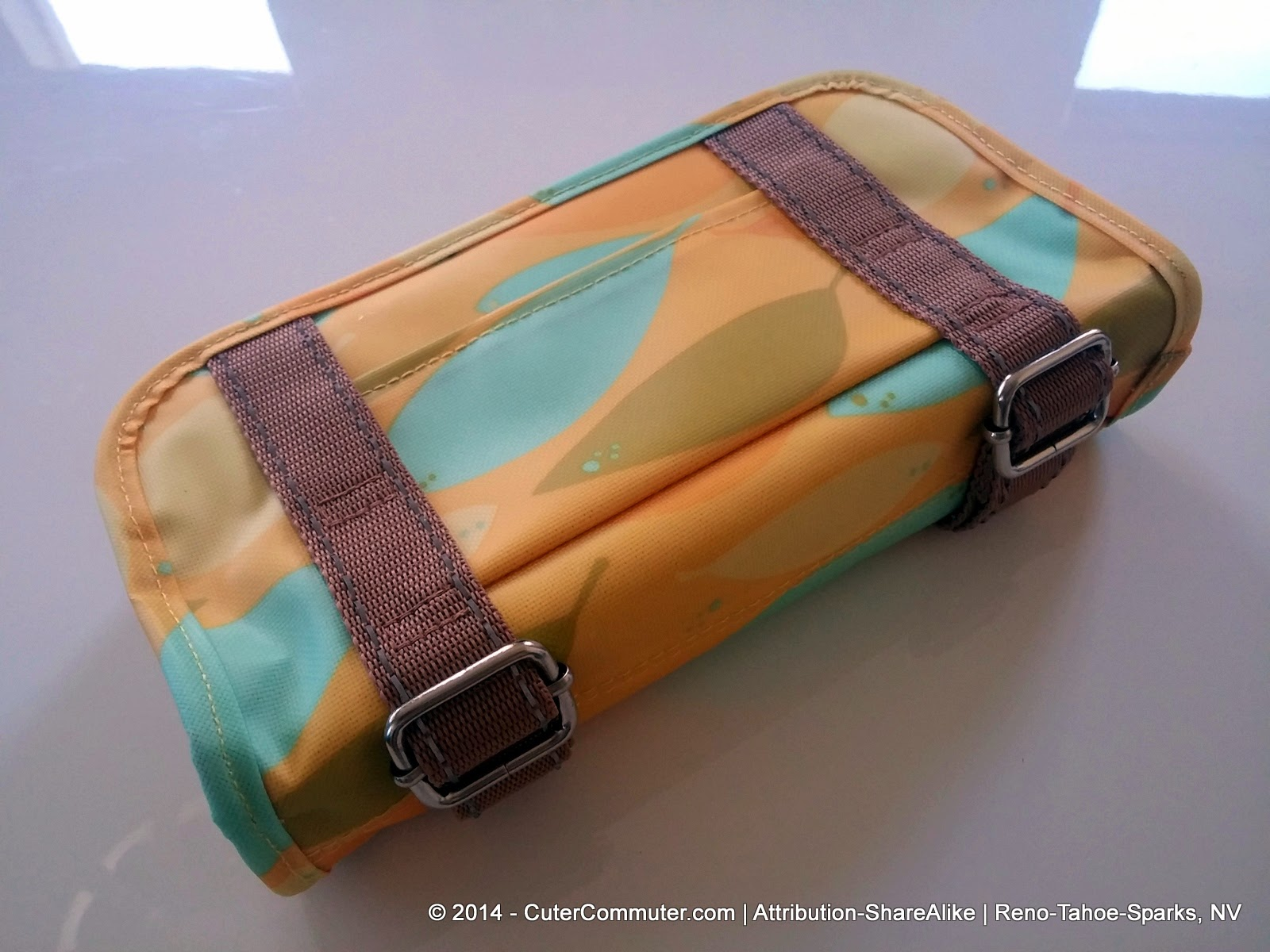 Back side patch pocket view of Po Campo Yellow Feathers Six Corners Handlebar Bag