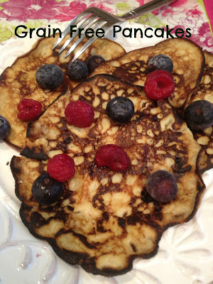 3 thin pancakes topped with blueberries and raspberries