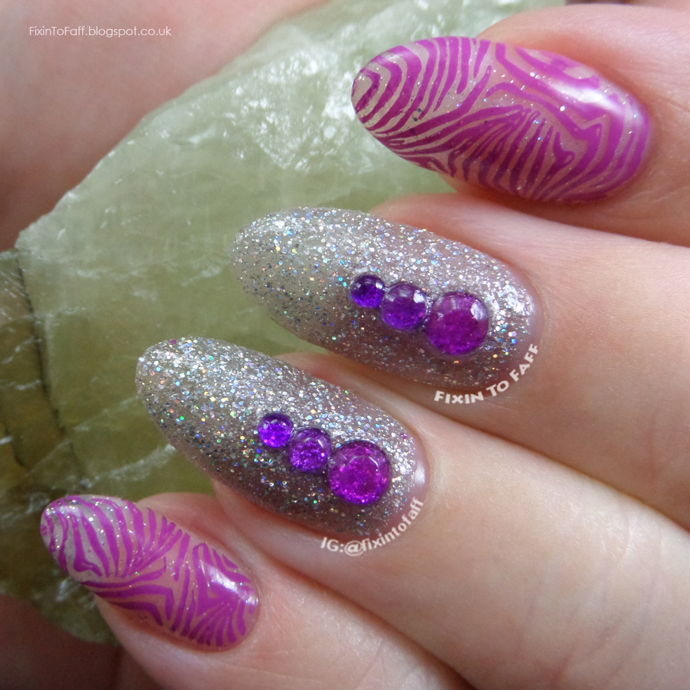 Purple zebra print negative space stamping nail art over holographic glitter base.
