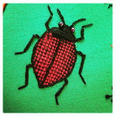 Broderi. Stumpwork fungus beetle. Woven plated stitch.