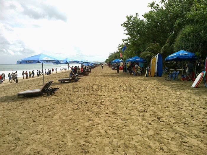 As the holiday season , Kuta Beach Bali is very crowded by tourists