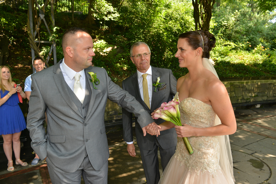 Bride and Groom meet after Dad gives away the bride