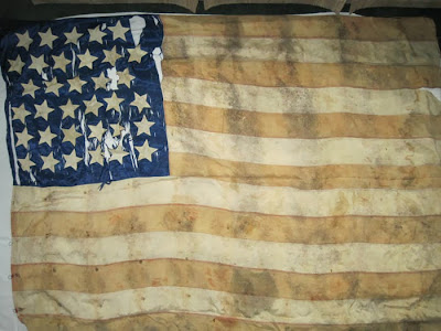 before image of 34 star flag undergoing conservation treatment at the studio of Spicer Art Conservation