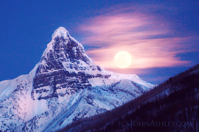 Last week's Sap Moon rises over the shoulder of Mount Saint Nicholas, in Glacier National Park (c) John Ashley