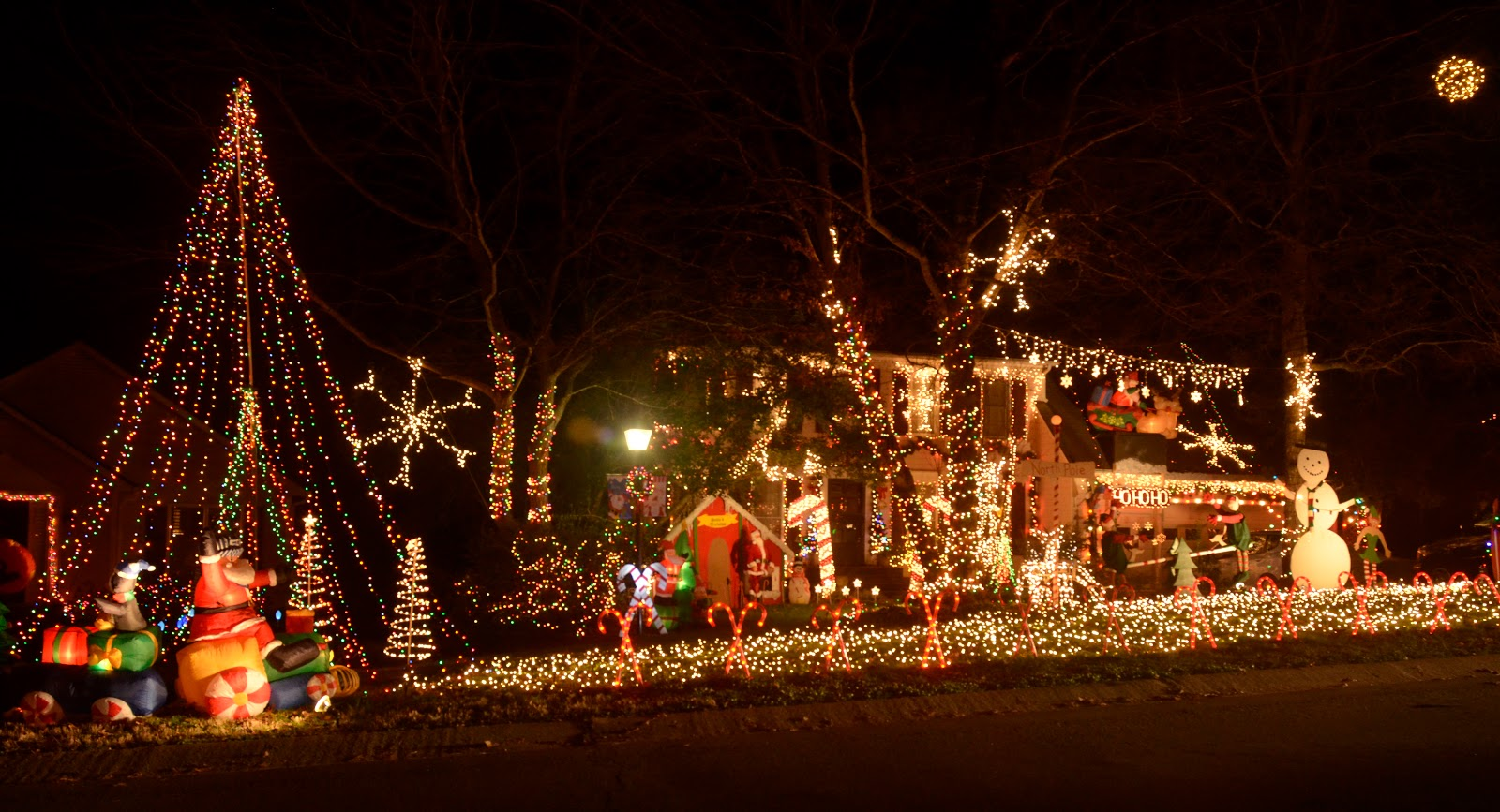 the entire front yard is covered in lights the house the roof the trees animation speakers playing christmas music see sawing elves a sleigh - How To Set Christmas Lights To Music