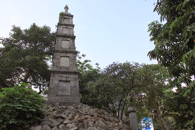 As you walk through the Three-Passage Gate,  you can see Pen Tower (Thap But), a ten-meter high stone structure resembles a writing brush in Hanoi, Vietnam