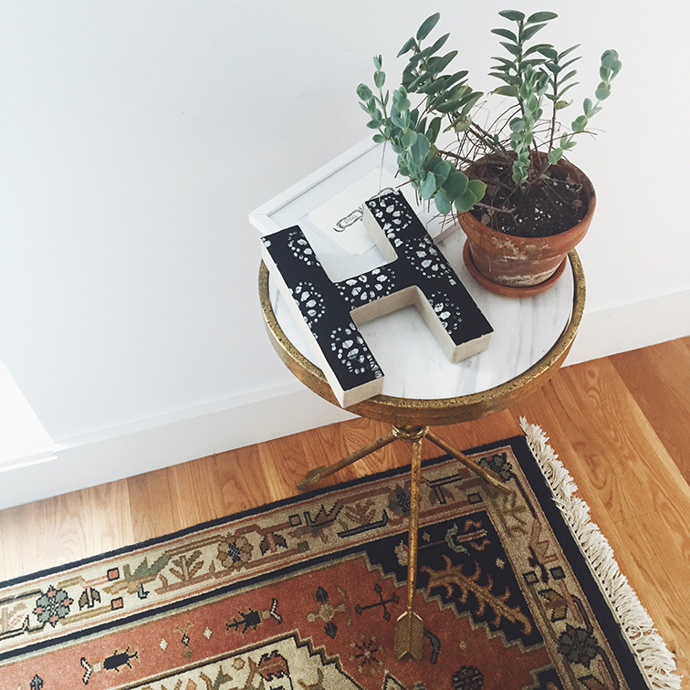 Urban Outfitters apartment Arrow Side Table, Plum & Bow Batik decorative letter, turkish rug runner, succulent, Forver Thine card