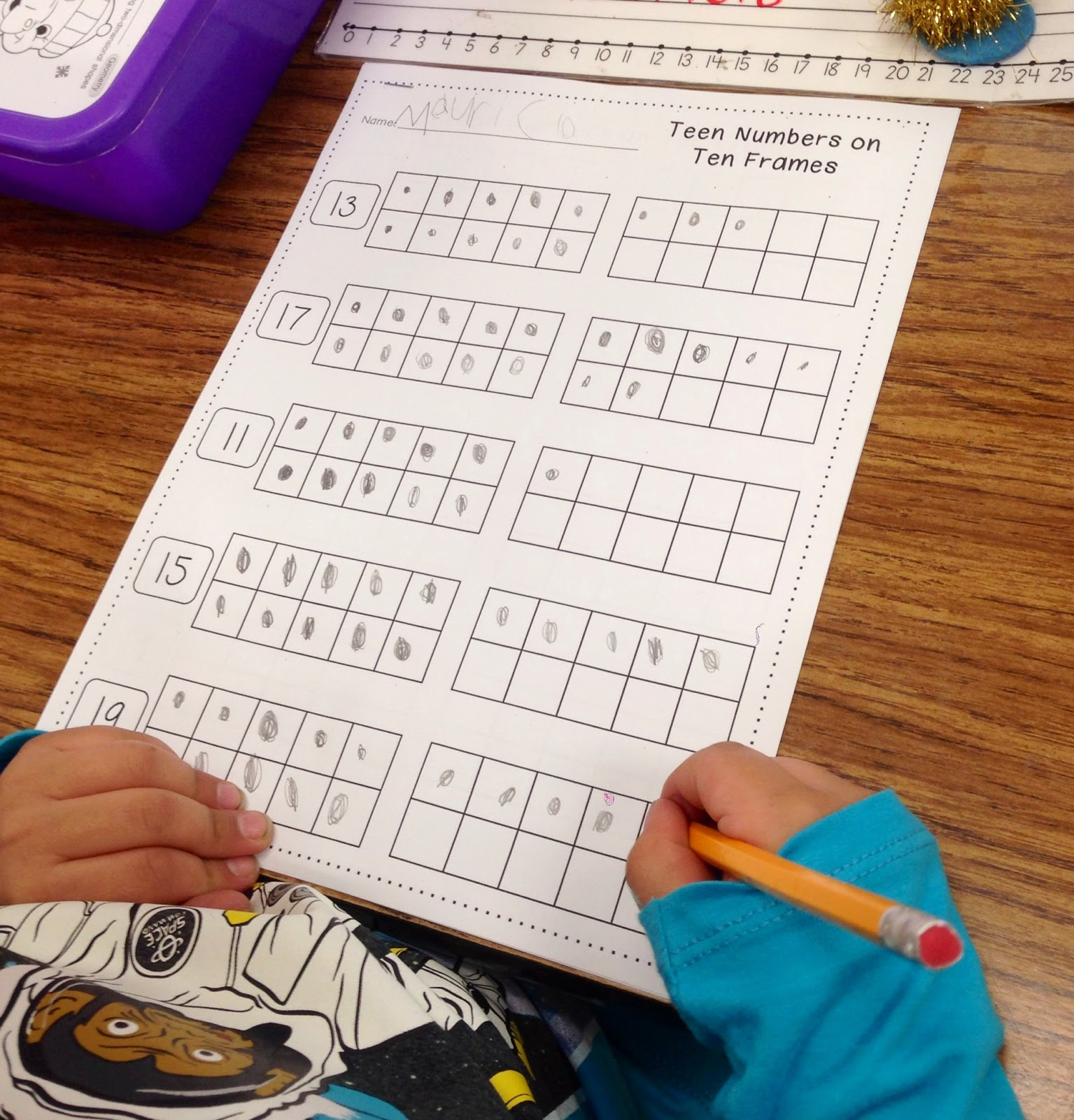 we matched teen numbers to the correct filled in ten frames