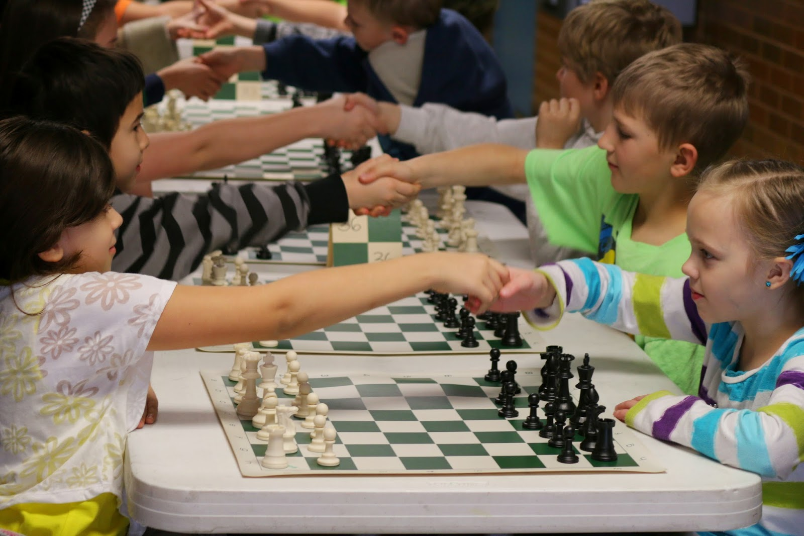 We have one major obstacle at our chess club: We don't have enough teachers  to keep all of our kids busy. We have done a few things that seem to work  well.
