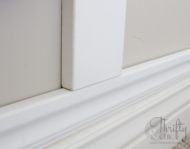 Great trick to have board and batten sit evenly on baseboards without having to remove existing baseboards!