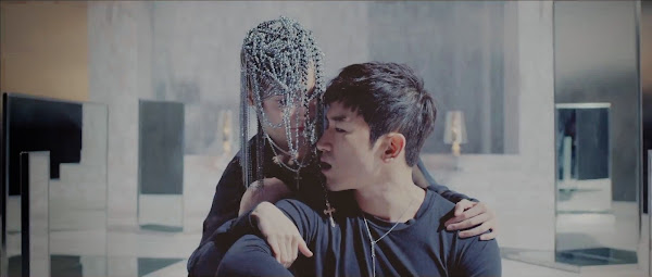 Shinhwa's Minwoo in the Sniper Music Video