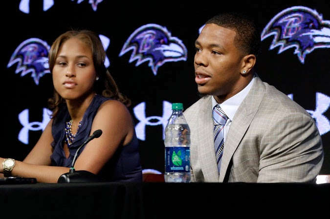 Ray Rice with his wife (Janay) at a news conference