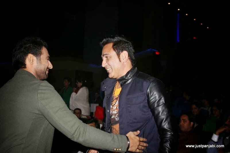 Harish Verma sharing a light moment with Sarabjit Cheema on Just Panjabi sponsored event PCGH