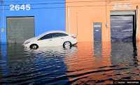 A car is stranded on Fairmont Avenue as high tides flood neighborhood streets after a snowstorm struck the U.S. East Coast, in Atlantic City, N.J., Jan. 24, 2016. (Credit: Reuters) Click to Enlarge.