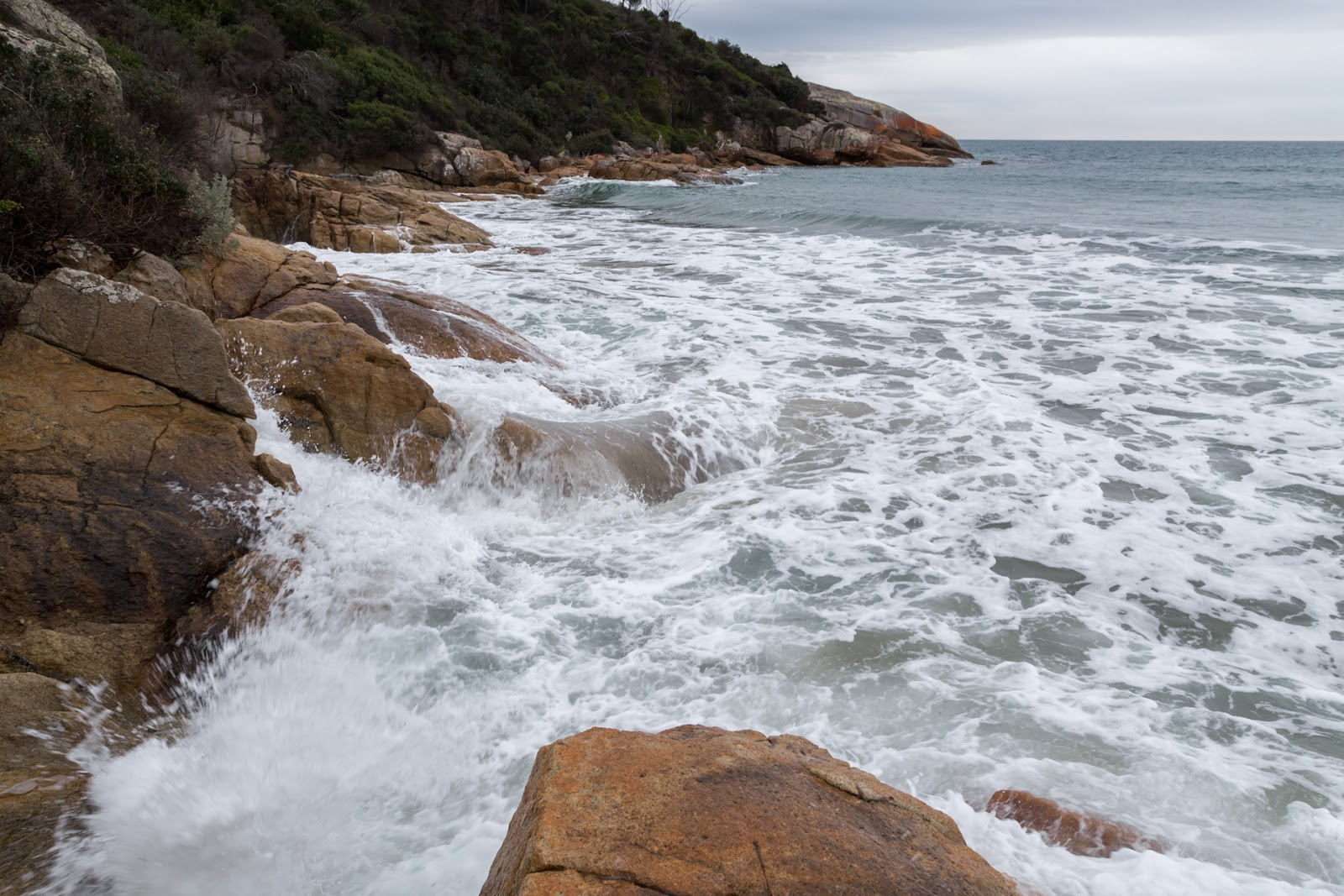 high tide against rocks lighthouse point wilsons promontory