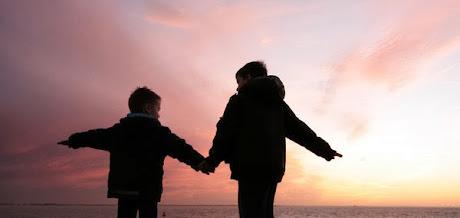 NAMC montessori developing student mentors boys holding hands