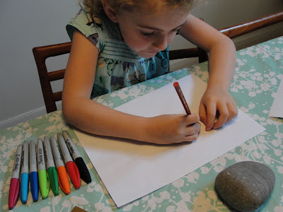 child drawing on paper
