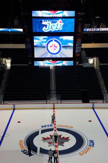 Jets Lay Down Logo At Center Ice At Mts