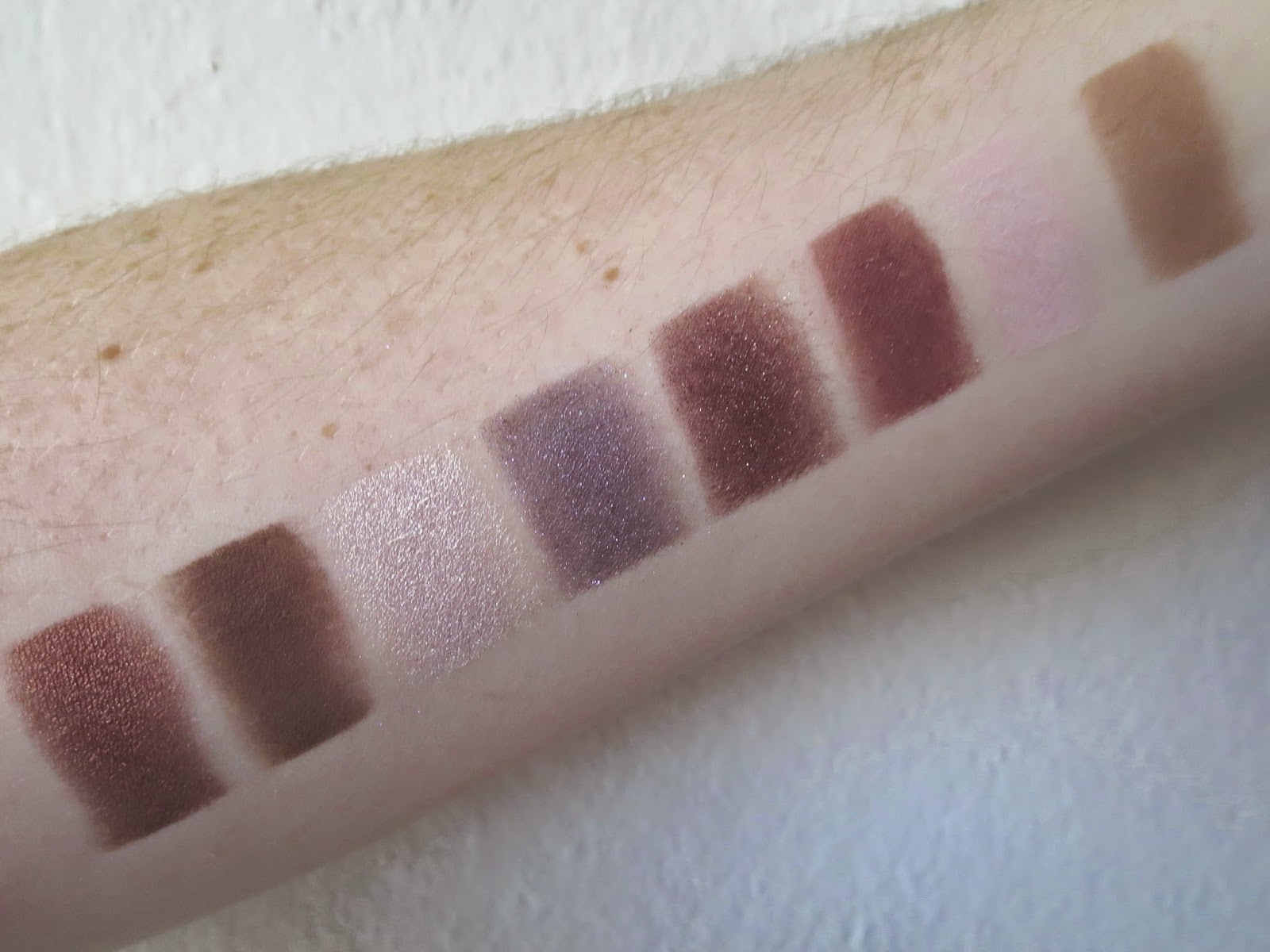 a picture of Too Faced Chocolate bar (swatch) ;  Amaretto, Triple Fudge, Champagne Truffle, Candied Violet, Black Forest Truffle, Cherry Cordial, Strawberry Bon Bon, Milk Chocolate