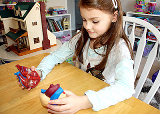 "Tessa was instantly captivated by the Learning Resource heart model. She quickly memorized the path of blood flow through the heart and body and then passionately regurgitated the information to anyone who would listen. As with the brain model that we examined earlier this school year, she cabbaged onto the heart and it became her favorite ""toy"" playmate for a couple of days. She even made it a special place to sleep next to her pillow at night!"