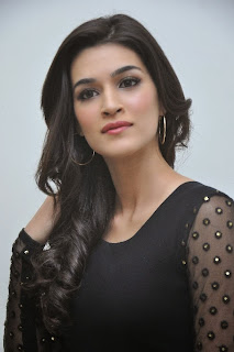 Actress Kriti Sanon Picture Gallery in Black Dress at 1 Nenokkadine Movie Audio Launch Function 0008.jpg