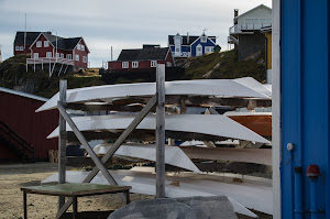 Stack of wooden kayaks in Sisimiut