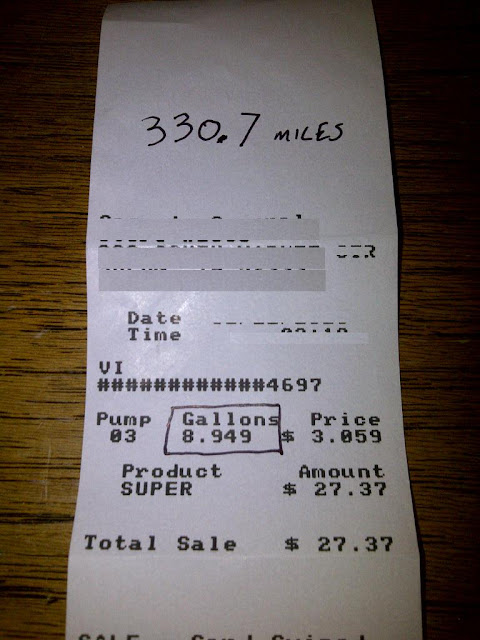 Receipt with 330.7 miles written and 8.949 gallons of gas printed