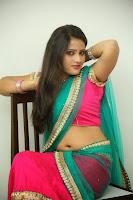 Anusha sizzling Pictures in half saree 061.JPG