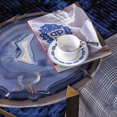 unusual coffee table design showing a blue glass patterned surface