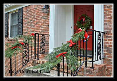 Side view of entry with garland - Dogs Don't Eat Pizza