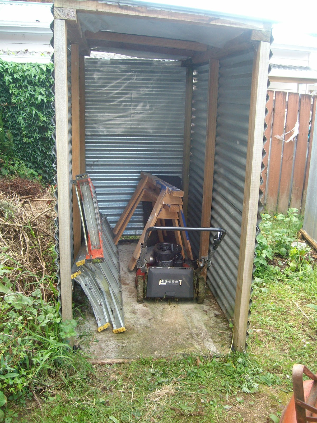 Tifany blog how to build a lawn tractor shed for Building a tractor barn