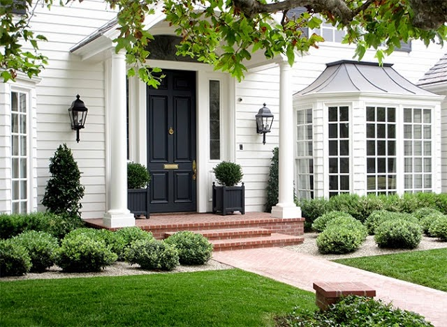The Door And Square Planter Boxes Are Uniform And Blend Nicely With The  Light Fixtures.