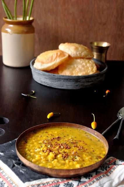 hing er kochuri ar dokaner chola'r daal (asafoeida flavoured stuffed indian fried bread and bengal gram curry with potatoes)