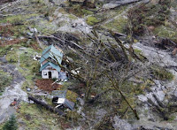 A damaged structure is pictured in this aerial photo in Index, Washington November 19, 2015. (Credit: Reuters/Jason Redmond) Click to Enlarge.