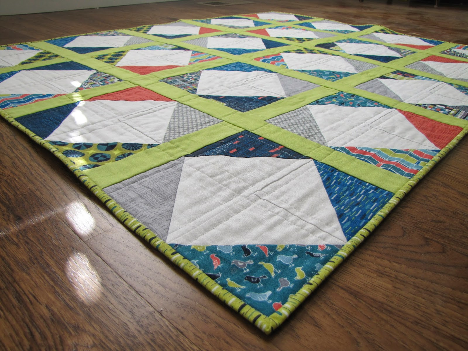 http://snippysisters.blogspot.com/2013/04/city-blocks-quilt-finish.html