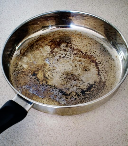 How to clean burnt milk from stainless steel pot
