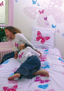 Papillon Girl's Bedding. Shown in a girl's bedroom.