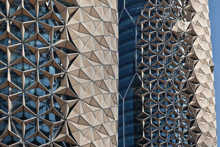 """Abu Dhabi will show a week of intense sunshine, temperatures steadily above 100 degrees Fahrenheit with 0% chance of rain.  In such extreme weather conditions, even architects listing environmental design as their top priority are up against a tough battle.  Never mind that the sand can compromise the structural integrity of the building, the intense heat and glare can render a comfortable indoor environment relatively impossible if not properly addressed.  For Abu Dhabi's newest pair of towers Al-Bahar, Aedas Architects have designed a responsive facade which takes cultural cues from the """"mashrabiya"""", a traditional Islamic lattice shading device."""