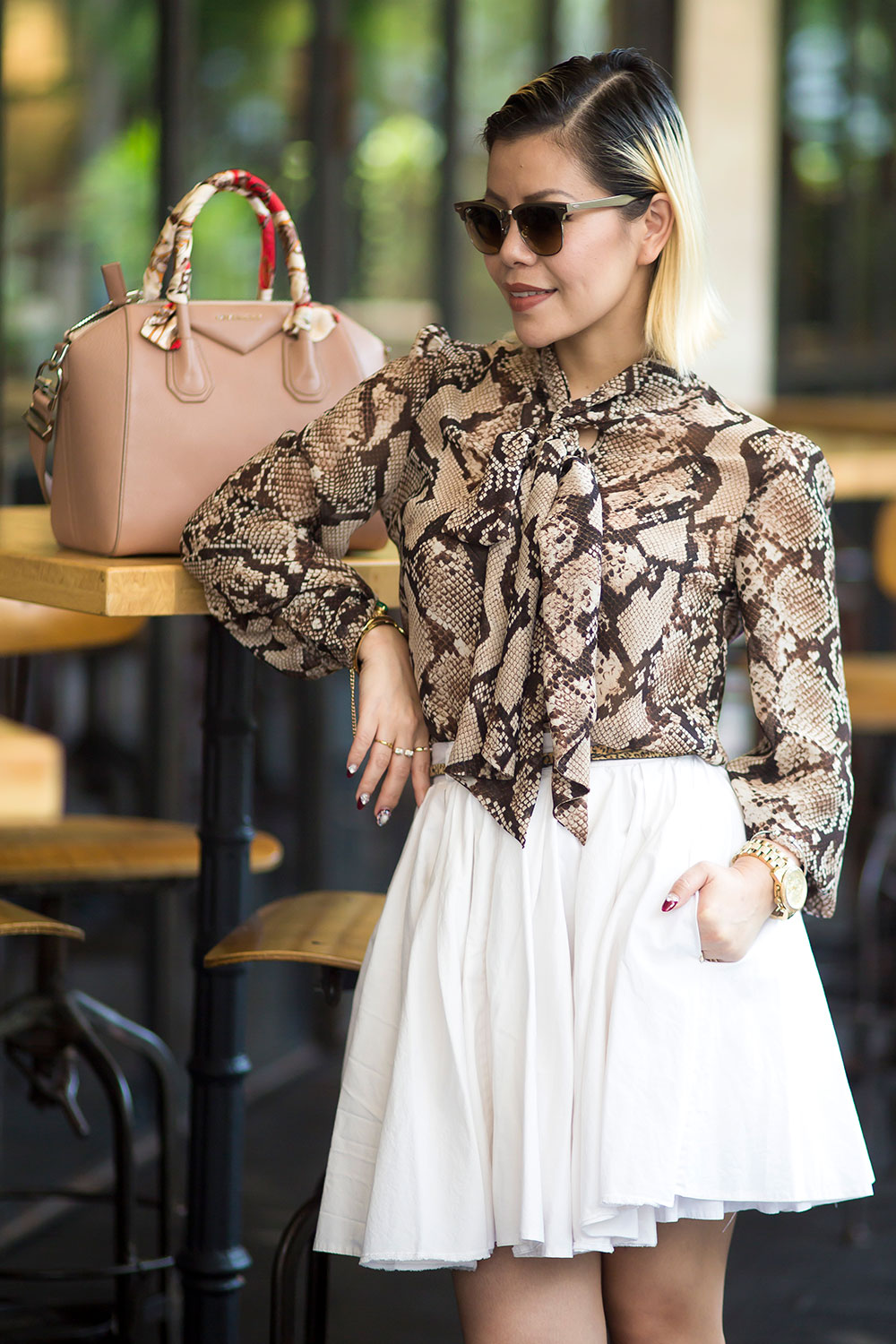 Crystal Phuong- Fashion Blogger- Snake skin blouse and white skirt