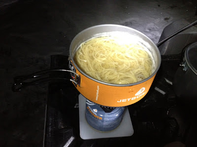 Image of cooking spaghetti while camping