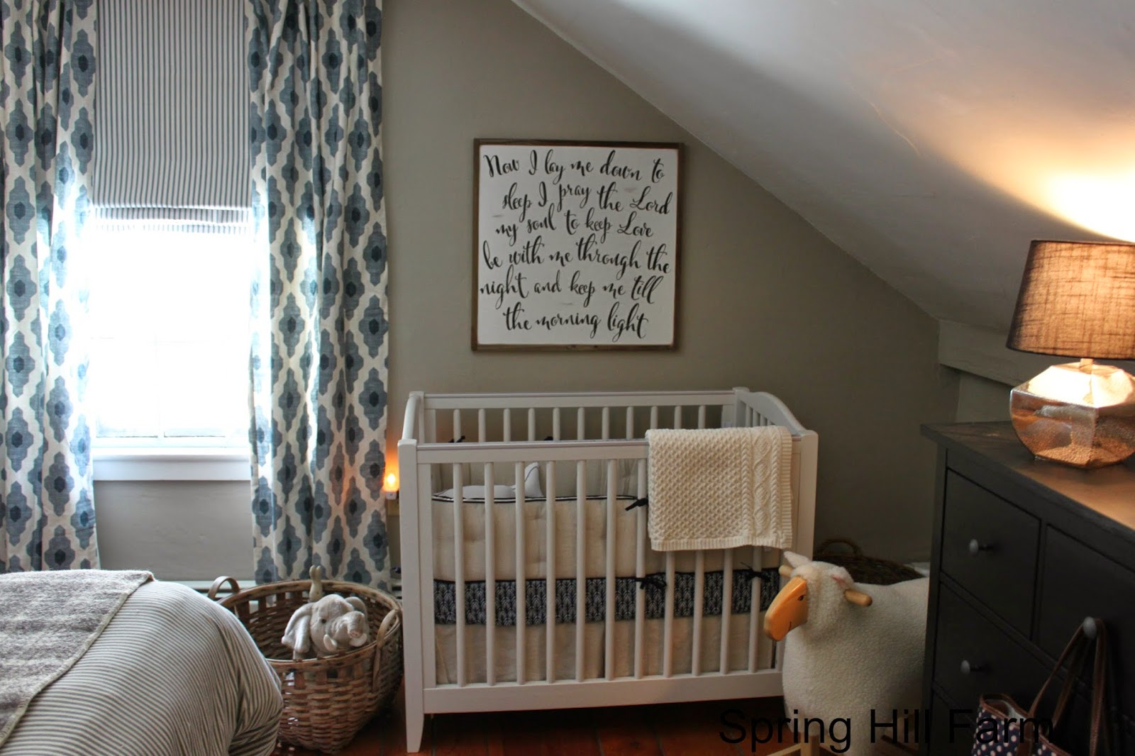 Spring hill farm Master bedroom with a crib